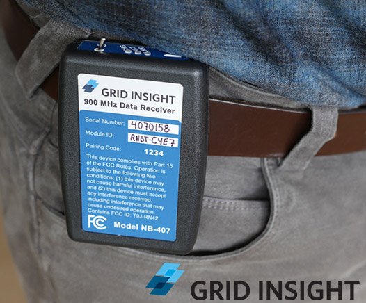 Grid Insight NB-407 Receiver shown attached to a belt
